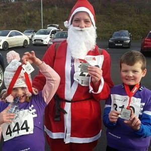 a family dressed as santas for the Cumbernauld Christmas Cracker event