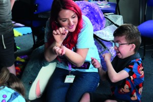 Support Worker Kerry enjoys some playscheme fun with SBH Scotland member, Lewis