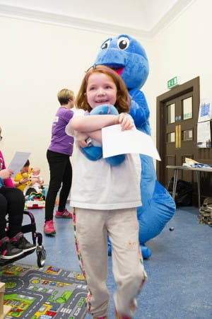 An SBH scotland member is delighted with her Spiney the Diney toy and certificate